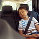 Boy sleeping while riding in car - PhotoDune Item for Sale