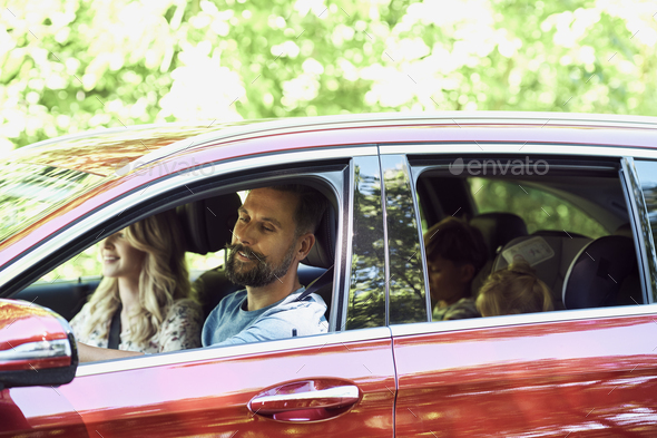 Family while trip driving by car - Stock Photo - Images