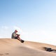 Man using smart phone with internet connection in the desert dunes alone - PhotoDune Item for Sale