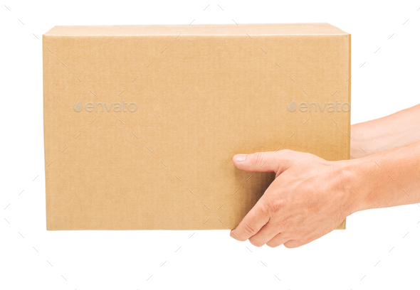 Hands hold corrugated cardboard box on isolated white background - Stock Photo - Images