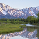 Grand Teton mountains above meadow and Snake River in early morning light - PhotoDune Item for Sale