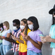 Young people wearing face mask using mobile smartphone outdoor - PhotoDune Item for Sale