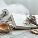Home still life with a cup of tea and a book. - PhotoDune Item for Sale