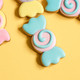Bright cookies in glaze on a yellow background. - PhotoDune Item for Sale