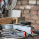Close-up of a miter saw in a carpenter's workshop. - PhotoDune Item for Sale