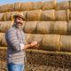Examining bales of hay - PhotoDune Item for Sale