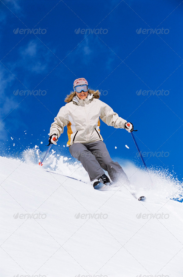 Young woman skiing - Stock Photo - Images