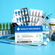 Health insurance card policy with meds and medical equipment on blue background. - PhotoDune Item for Sale
