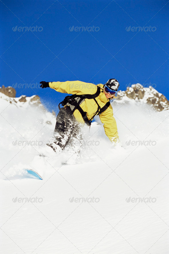 Young woman snowboarding - Stock Photo - Images
