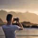 Man during photographing landscape with cliff at sunset - PhotoDune Item for Sale