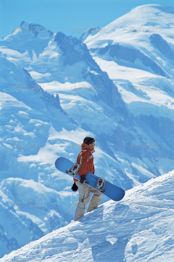 Young man snowboarding - Stock Photo - Images