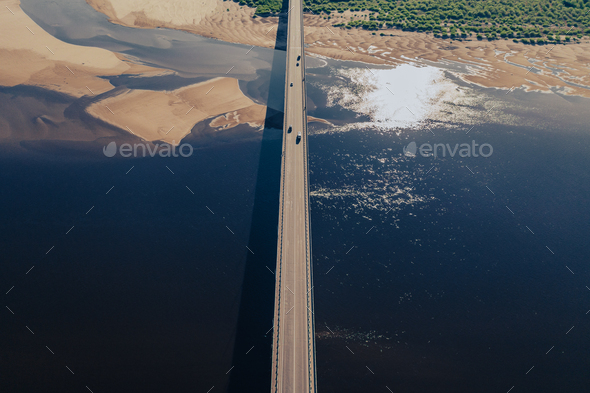 Aerial view of bridge over river in sunset light - Stock Photo - Images