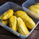 Golden yellow musang king durian pulp flesh in container on wooden surface - PhotoDune Item for Sale
