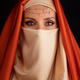 Close Up Portrait Of Beauty Young Muslim Woman In Hijab Looking At Camera - PhotoDune Item for Sale