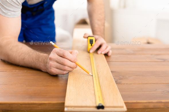 Unrecognizable Carpenter Measuring Wooden Board Making Furniture Indoor - Stock Photo - Images