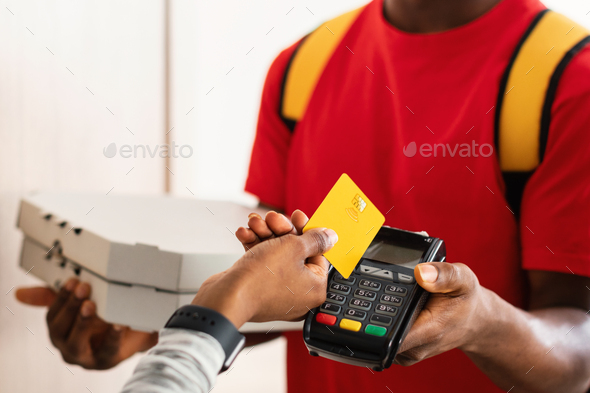 Unrecognizable Customer Paying Courier Putting Credit Card To Terminal Indoors - Stock Photo - Images