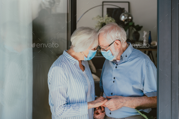 Elderly couple at home during covid-19 pandemic quarantine - Stock Photo - Images
