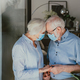 Elderly couple at home during covid-19 pandemic quarantine - PhotoDune Item for Sale