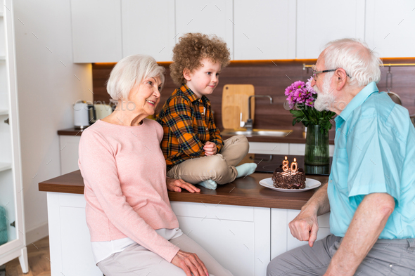 Grandparents and grandson playing at home - Stock Photo - Images