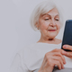 Elderly woman with smartphone at home - PhotoDune Item for Sale