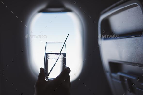 Passenger enjoy drink during flight - Stock Photo - Images