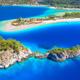 Aerial view of sea bay, rock, sandy beach, trees, mountain - PhotoDune Item for Sale