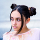 Teen girl with hair buns looking away - PhotoDune Item for Sale