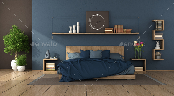 Blue modern bedroom with wooden double bed - Stock Photo - Images