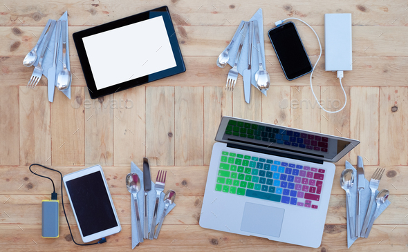Technological table with electronic devices, laptop computer, tablet, smartphones, wooden background - Stock Photo - Images