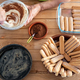 One people busy preparing a sweet tiramisu. All ingredients in the wooden table. - PhotoDune Item for Sale