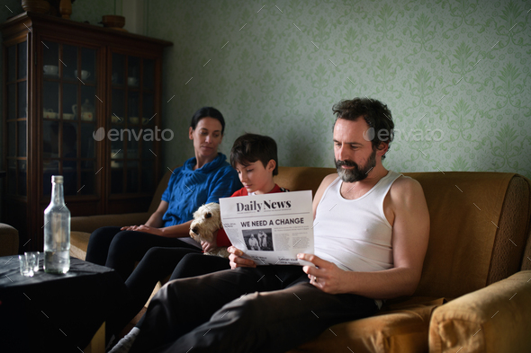 Portrait of poor mature couple with small daughter and dog indoors at home, poverty concept - Stock Photo - Images