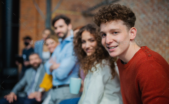 Portrait of businesspeople entrepreneurs indoors in office, looking at camera - Stock Photo - Images