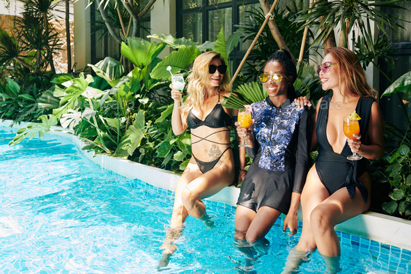 Female Friends Enjoying Small Pool Party - Stock Photo - Images