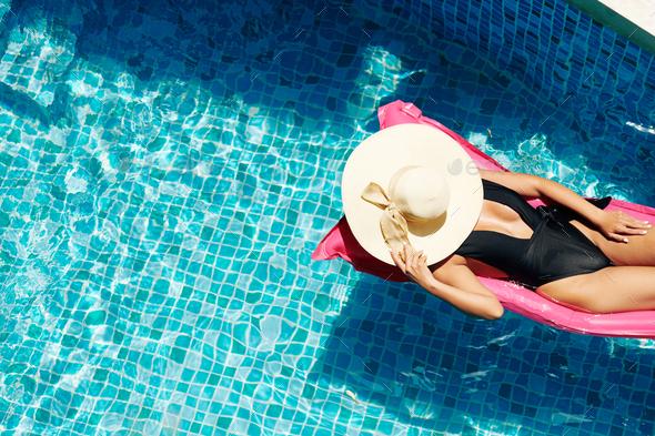 Woman Sunbathing on Floating Mattress - Stock Photo - Images