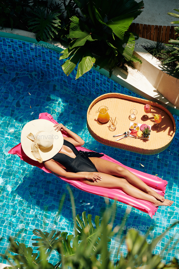 Young Woman in Bikini and Straw Hat - Stock Photo - Images