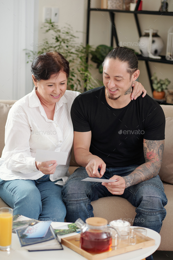 Mother with son remembering the past - Stock Photo - Images