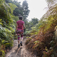 Single woman exercising by hiking in tropical rainforest in the morning - PhotoDune Item for Sale