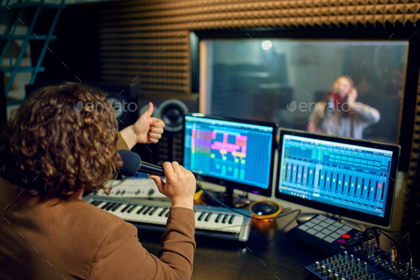 Musician and female performer, recording studio - Stock Photo - Images