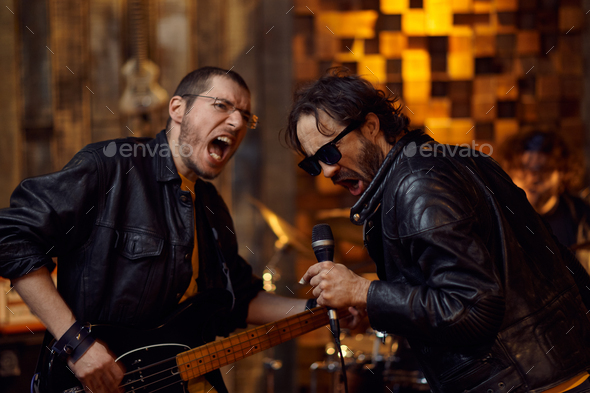 Two artists at microphone, song performing - Stock Photo - Images