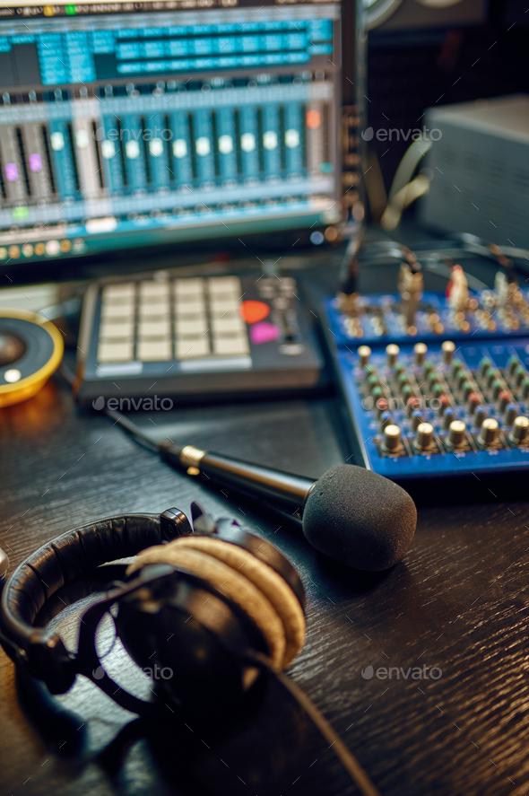 Headphones on the table, recording studio interior - Stock Photo - Images