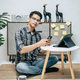Young man working from home with digital tablet and smartphone - PhotoDune Item for Sale