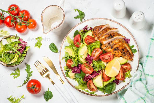 Healthy salad with Grilled chicken fillet on white - Stock Photo - Images