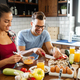 Happy young couple have fun in modern kitchen while preparing fresh food - PhotoDune Item for Sale