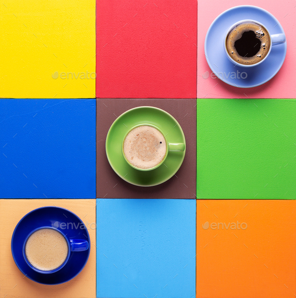 Cup of coffee at colorful abstract background - Stock Photo - Images