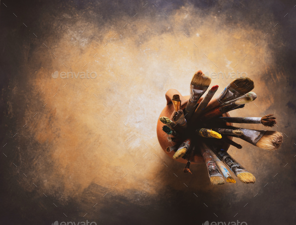 Paint brush in clay jug at  art painting canvas as abstract background texture. Paintbrush painting - Stock Photo - Images