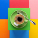 Cup of coffee and spoon at colorful abstract background - PhotoDune Item for Sale