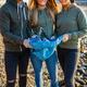 Smiling team of volunteers holding garbage bag at beach - PhotoDune Item for Sale