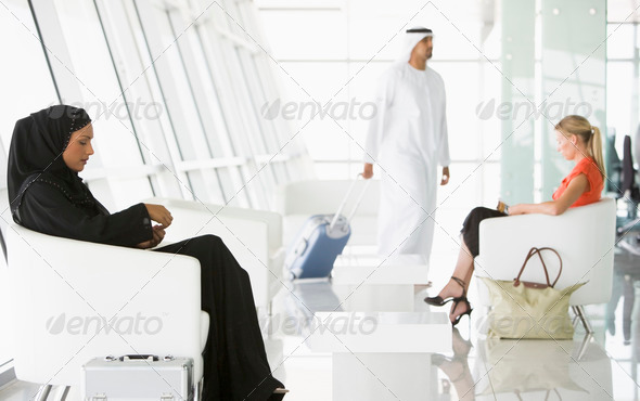Passengers waiting in airport departure lounge - Stock Photo - Images