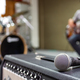 Closeup of microphone on musician blurred background - PhotoDune Item for Sale