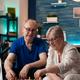 Retirement aged people sitting on living room sofa - PhotoDune Item for Sale